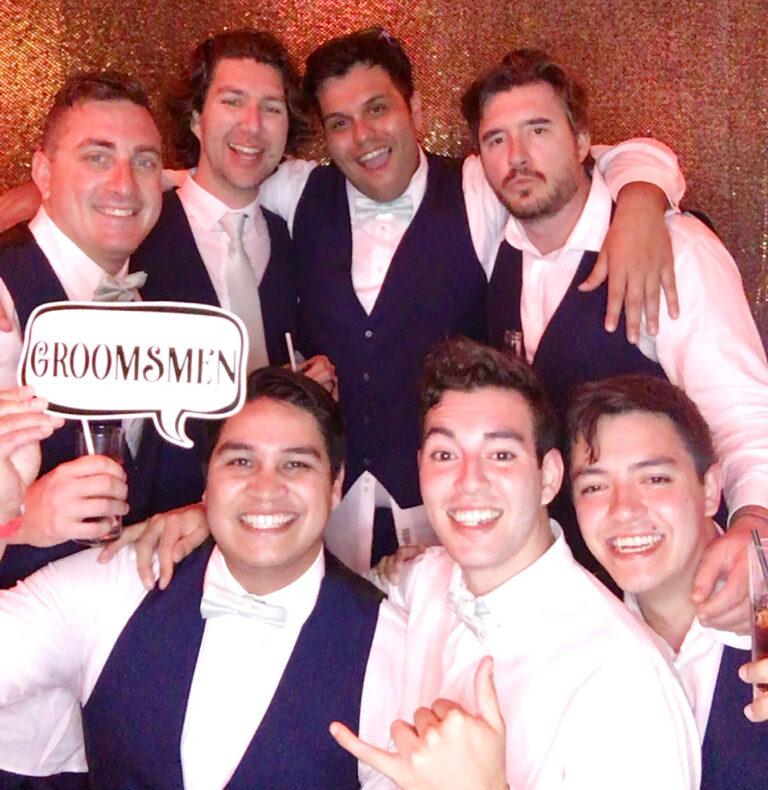 wedding groomsmen prop men suits smiles 1